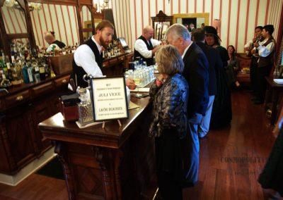 Bartenders in Saloon serving people drinks