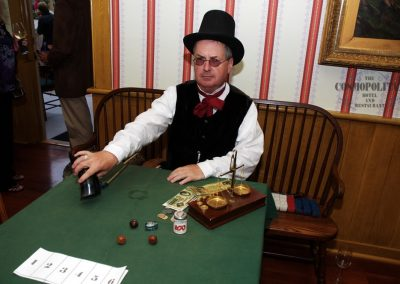 Costumed Character sitting at a gaming table