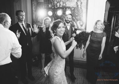 a bride and guests dancing in the parlor