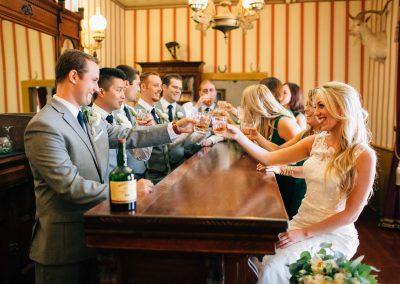 of a bridal party enjoying a shot at at bar