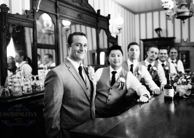 a groom and his groomsmen standing in a bar
