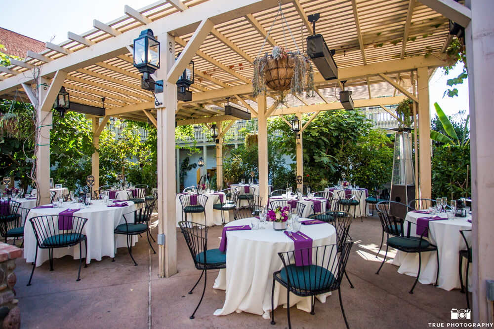 outside dining tables under a pergola